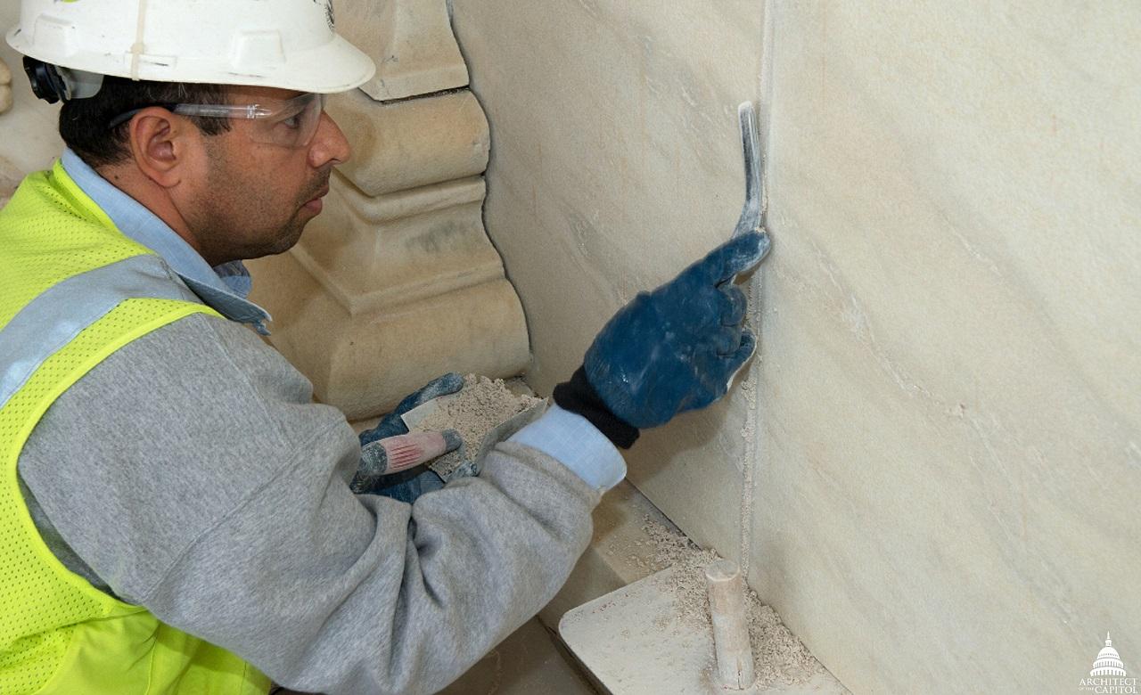 worker repairing the wall