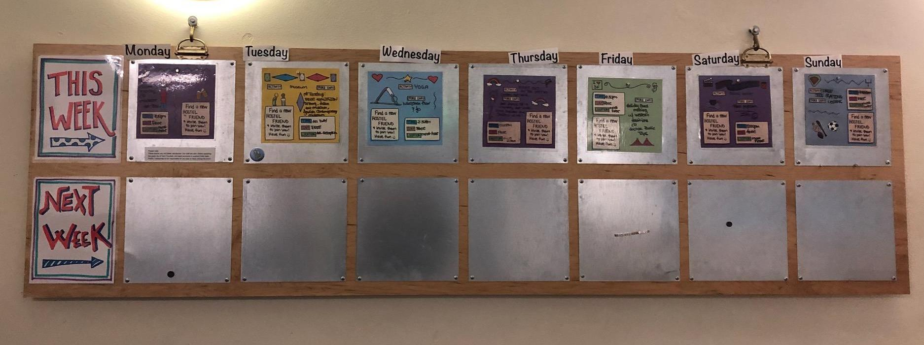 Hostel events board hanging on a wall
