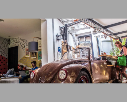 Selina Hostel reception with VW Bug as desk