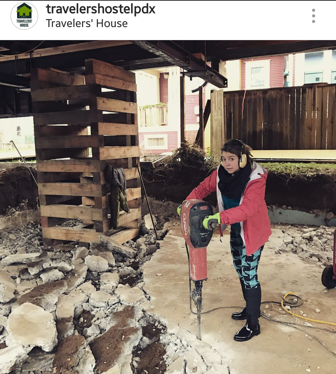 Picture of a girl using a heavy jackhammer