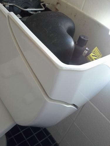 broken toilet hostel