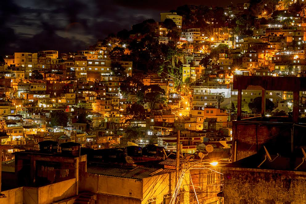 Favela Experience hostel neighborhood lit up at night