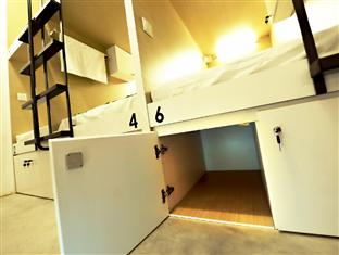 Hostel locker under a bunk bed