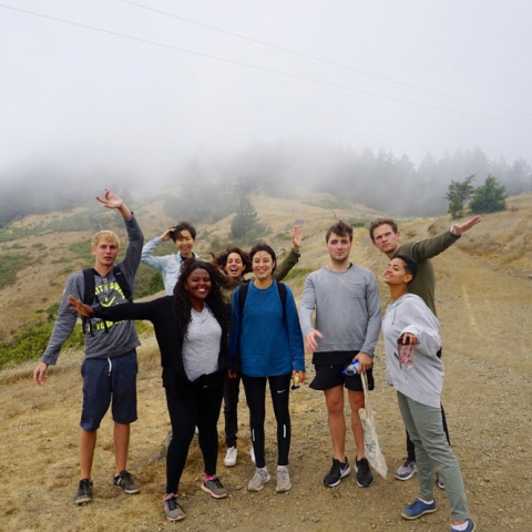 A group of young people on a hike outside