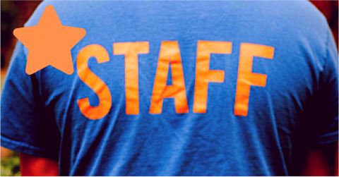 Back of Shirt says Staff