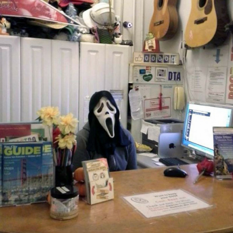 Unfriendly Scary Receptionist at Hostel Front Desk