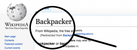 Magnifying Glass on Backpacker Word