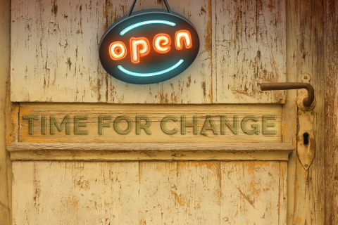 Picture of wooden wall or door with Time for Change sign and open sign