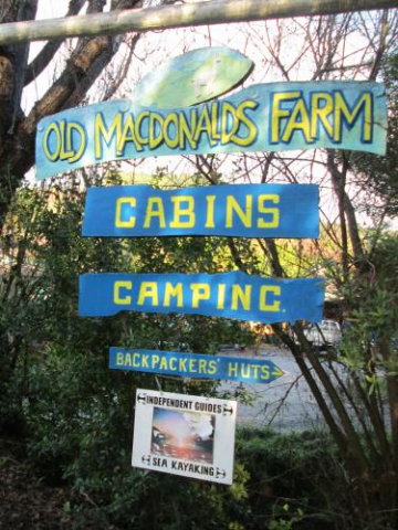 indepent guide sign entrance to old macdonalds farm camping backpacker huts bush
