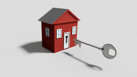 red cartoon house with key going in
