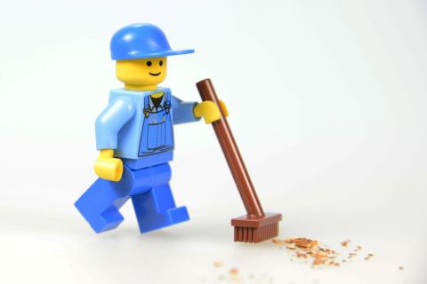 Lego man sweeping