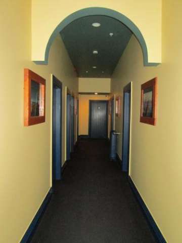 och archhitecture paint colonial interior villa countryhouse backpacker hostel hallway hall doors rooms pictures frame yellow walls