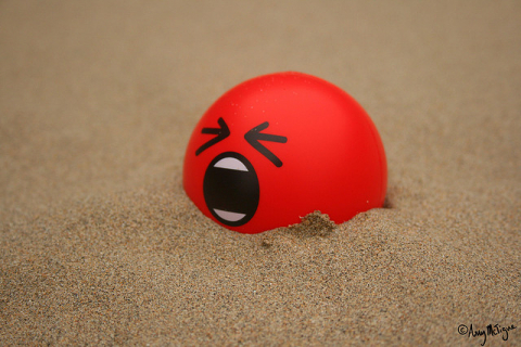 Red squishy stress ball with angry face