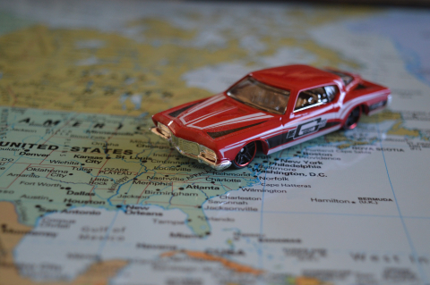 Old American car over US map